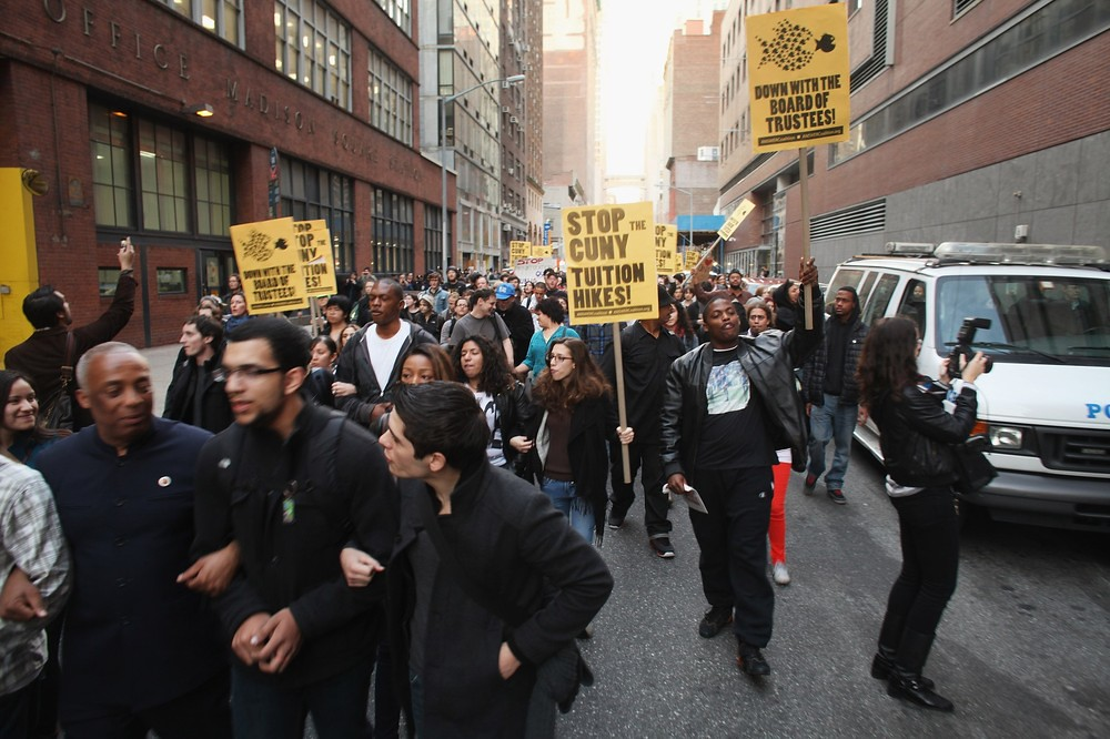 People protest against tuition hikes near Baruch College.